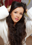 A young woman in a white robe Stock Photography