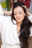 Young woman in a white robe Royalty Free Stock Photography
