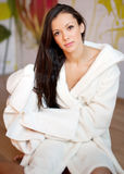 Young woman in a white robe Royalty Free Stock Images