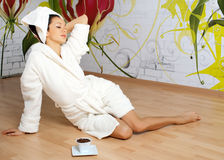 Young woman in a white robe stock image
