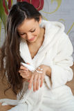 Young woman in a white robe Stock Photos