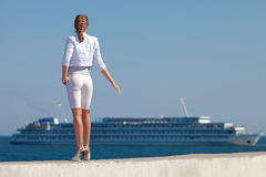 Young woman in white at the sea Stock Photo