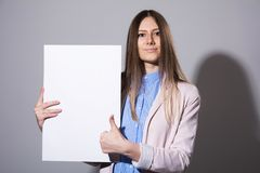 Young woman with white sheet for advertising Royalty Free Stock Photo