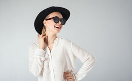 Young woman in white shirt,  glasses and hat Royalty Free Stock Photo