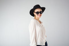 Young woman in white shirt,  glasses and hat Royalty Free Stock Photos