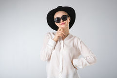 Young woman in white shirt,  glasses and hat Stock Photography