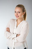 Young woman in white shirt Stock Photography