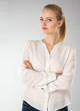 Young woman in white shirt Stock Images
