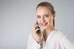 Young woman in white shirt with smart phone Stock Photo