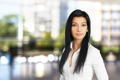 Young woman in white shirt Stock Image