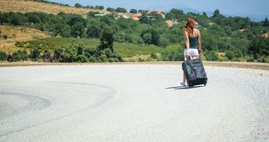 Young woman on the road with baggage Royalty Free Stock Photo