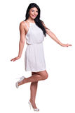 Young woman in a white summer dress isolated over white Royalty Free Stock Image