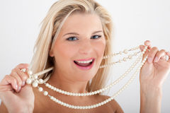 Young woman with white teeth and pearls Stock Photography