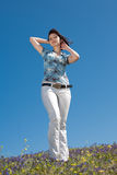 Young woman in white trousers outdoors Royalty Free Stock Image