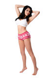 Young woman in white underwear stretching tiptoe Royalty Free Stock Photography