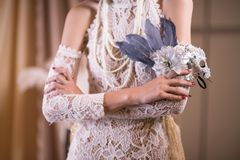 Woman in white vintage style dress. female hand hold carnival ma Stock Image