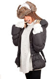 Young woman in white winter hat and coat Stock Photo