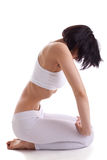 Young woman in white yoga exercise with abdomen Royalty Free Stock Images