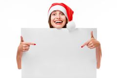 Young woman with whiteboard on Christmas Royalty Free Stock Photos