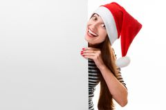 Young woman with whiteboard on Christmas Stock Photography