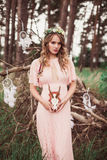 Young Woman With Whitetail Deer Skull And Antlers Royalty Free Stock Photo