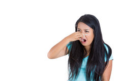 Young Woman Who Covers Her Nose, Looks Away, Something Stinks, Very Bad Smell, Situation Stock Images