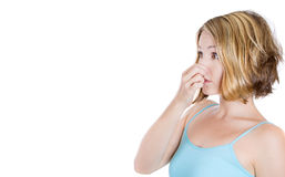 Young woman who covers her nose, looks at a copy space , something stinks, very bad smell, situation Stock Photos