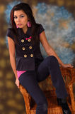 Young woman on wickerwork chair Royalty Free Stock Photos