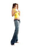 Young woman in wide jeans Royalty Free Stock Images