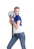 Young woman wiht megaphone or bullhorn Royalty Free Stock Photo
