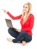 Young woman wiith laptop  showing something Royalty Free Stock Image