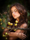 Young woman with wild apples Royalty Free Stock Image