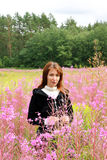 Young woman  in the wild flowers field Royalty Free Stock Photo
