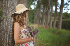Young woman with wild flowers Stock Photos