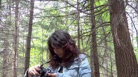 Young woman wildlife photographer in action stock video