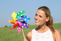 Young woman with wind engine Stock Image