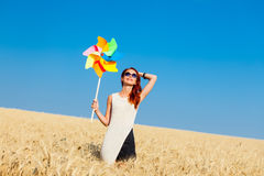 Young woman with wind toy Stock Photography