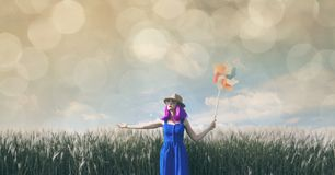Young woman with wind toy Royalty Free Stock Photos