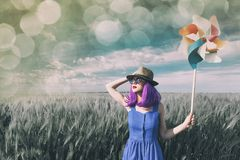Young woman with wind toy Royalty Free Stock Photography