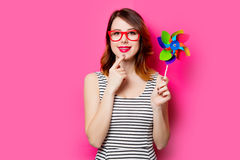 Young woman with wind toy Royalty Free Stock Images