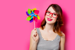 Young woman with wind toy Stock Photos
