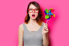 Young woman with wind toy Stock Image