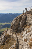 Young woman on winding hiking trail at wendelstein mountain Stock Images
