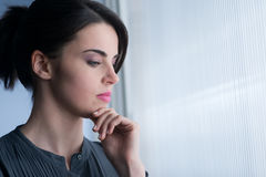 Young woman at window Stock Photography