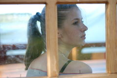 Young woman and window Stock Photo
