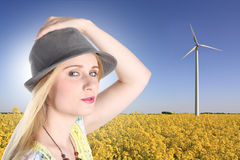 Young woman with windturbine stock photos