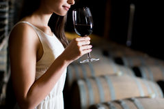 Young woman in the wine cellar Royalty Free Stock Photography