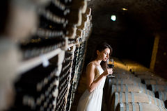 Young woman in the wine cellar Royalty Free Stock Image