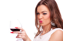 Young woman with wine sending kiss Stock Photos