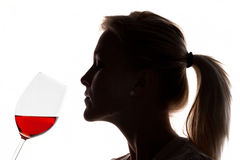Woman with red wine in a wine glass stock image